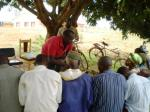 Meeting under the mango tree